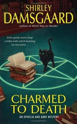 Book Charmed to Death: An Ophelia and Abby Mystery by Shirley Damsgaard