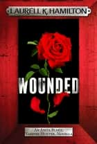 Wounded ebook by Laurell K. Hamilton